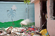 A man clears rubble from a small room at a former school on July 7, 2010 in Port-au-Prince, Haiti.