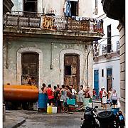 People queing for drinking water, Havana, Cuba.
