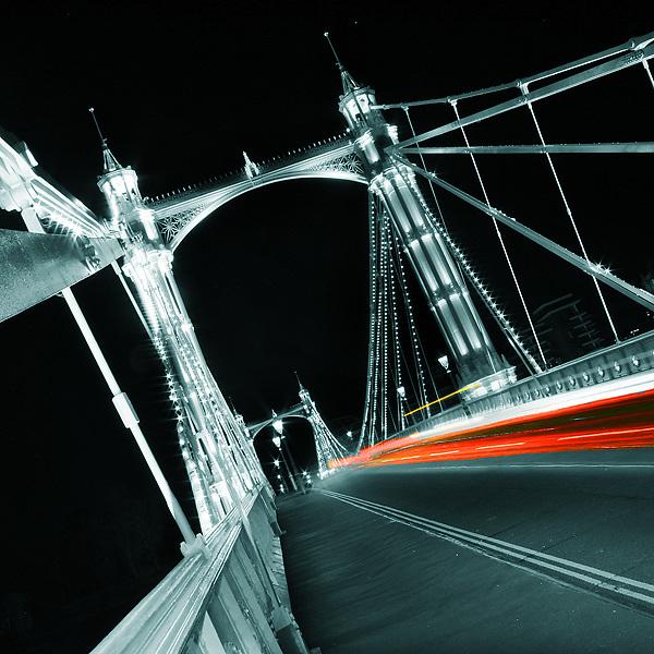 Albert Bridge, London. A night shot showing light trails from passing traffic
