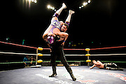 Lucha Libre AAA wrestler Vampiro prepares to bodyslam Silver King at a match in Sacramento, CA March 28, 2009.