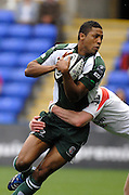 Reading, GREAT BRITAIN,  Exiles, Delon ARMITAGE looks for support after being tackled by Tom DILLON, during the Guinness Premiership match London Irish vs Newcastle Falcons, at Madejski. England, Sun. 23.09.2007  [Mandatory Credit, Peter Spurrier/Intersport-images].....