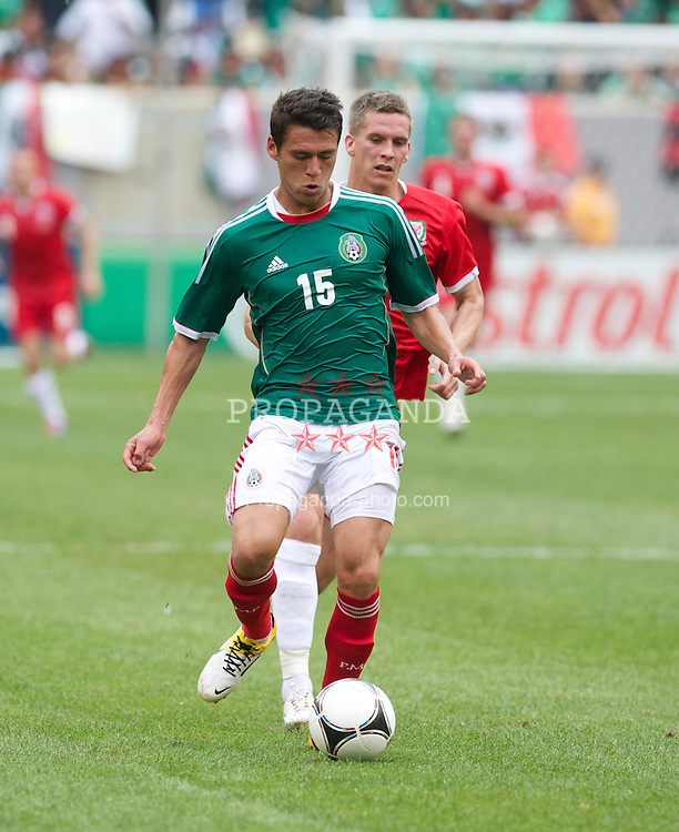 EAST RUTHERFORD, NEW JERSEY, USA - Sunday, May 27, 2012: Wales' Steve Morison and Mexico's Hector Moreno during an International Friendly at the MetLife Stadium. (Pic by David Rawcliffe/Propaganda)