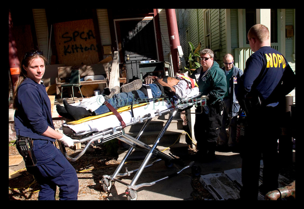 Dec 21st, 2005. A roofing contractor falls from a roof in Uptown New Orleans. Paramedics soon on the scene take the injured man to hospital.