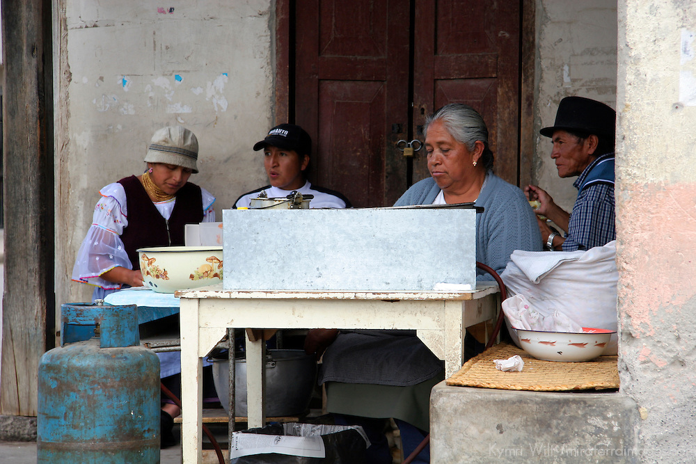 South America, Ecuador, Peguche. A homecooked meal is shared with locals in the Andean village of Peguche in Ecuador.