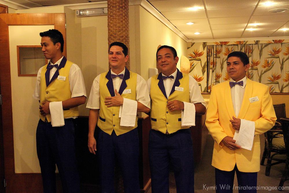 South America, Brazil. Amazon River. Iberostar Grand Amazon Waiters.