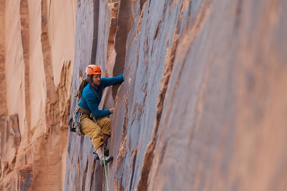 Dustin leading Pinhead, 5.10b at Wallstreet in Moab, UT
