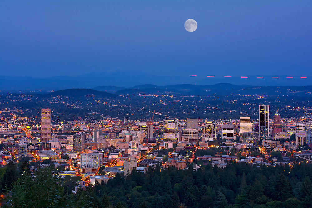 Supermoon rising over the Portland skyline.