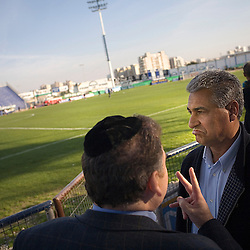 Bnei Sakhnin team owner Mazen Ghanayem, talks with Jewish friend and soccer agent Jozef Spiegel, during half time of a qualifying game, Ramat Gan, Israel, Jan. 31, 2006. His team has a mixture of Israeli-Arab, Israeli, and foreign players. Football star Abbas Suan, himself an Israeli-Arab, who still faces criticism and racism resulting from the unsettled conflict between the Israelis and Palestinians.