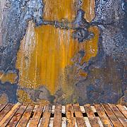 Rusted iron wall and metal bars. Find art in Seattle's industrial and bohemic Georgetown neighborhood, Washington, USA.