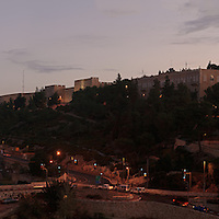 The walls of Jerusalem's Old City near the Jaffa Gate and Citadel of David overlook the Sultan's Pool and Derech Hevron in this pre-dawn panoramic view. WATERMARKS WILL NOT APPEAR ON PRINTS OR LICENSED IMAGES.
