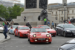 Image &copy;Licensed to i-Images Picture Agency. 18/06/2014. <br /> <br /> Pictured are the Porsche 944's travelling through Trafalgar Square leaving London for Norway.<br /> <br /> Nine Porsche 944's, all bought for &pound;1100 of less, set of from the Mall, London on a rally across Northern Europe to Nordkapp in Norway in an attempt to raise &pound;100,000 for Help For Heroes.<br /> <br /> Wednesday 18th June 2014<br /> Picture by Ben Stevens / i-Images