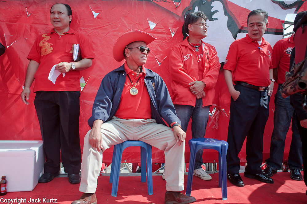 "Mar. 26, 2009 -- BANGKOK, THAILAND: Veera Musigapong, a leader of the United Front of Democracy Against Dictatorship (UDD), waits to speak at a UDD rally in Bangkok Thursday. Veera was a deputy leader of former Prime Minister Thaksin Shinawatra's party. More than 30,000 members of the United Front of Democracy Against Dictatorship (UDD), also known as the ""Red Shirts""  and their supporters descended on central Bangkok Thursday to protest against and demand the resignation of current Thai Prime Minister Abhisit Vejjajiva and his government. Abhisit was not at Government House Thursday. The protest is a continuation of protests the Red Shirts have been holding across Thailand in March.  Photo by Jack Kurtz"