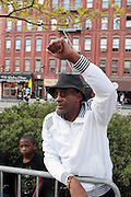 September 16, 2012- Harlem, New York: Crowd Participant at the 42nd Annual African American Day Parade held along Adam Clayton Blvd on September 16, 2012 in Harlem New York City. The first African American Day Parade was held in September 1969 in Harlem. The first Grand Marshal was Congressman Adam Clayton Powell, Jr. The purpose of the parade is to provide an opportunity for African people to join together on a Special Day to highlight history and salute African people throughout America and the world for their outstanding achievements.  (Terrence Jennings)