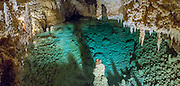 """Halo Lake panorama, Caverns of Sonora, Sutton County, Texas, USA. The world-class Caverns of Sonora have a stunning and sparkling array of speleothems (helictites, stalactites, stalagmites, flowstone, coral trees, and other calcite crystal formations). National Speleological Society co-founder, Bill Stephenson said, after seeing it for the first time, """"The beauty of Caverns of Sonora cannot be exaggerated...not even by a Texan!"""" Geologically, the cave formed between 1.5 to 5 million years ago within 100-million-year-old (Cretaceous) Segovia limestone, of the Edward limestone group. A fault allowed gases to rise up to mix with aquifer water, making acid which dissolved the limestone, leaving the cave. Between 1 and 3 million years ago, the water drained from the cave, after which speleothems begain forming. It is one of the most active caves in the world, with over 95% of its formations still growing. Sonora Caves are on Interstate 10, about half-way between Big Bend National Park and San Antonio, Texas. This panorama was stitched from 3 overlapping photos."""