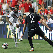Costa Rica Defender Junior Diaz (15) attempts a shot as Republic of Ireland Defender Stephen Kelly (2) defends in the second half of the inaugural freedom cup between Ireland and Costa Rica Friday. June. 6, 2014 at PPL Park in Chester PA.