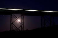 Salisbury Mills - The full moon rises by the Moodna Viaduct railroad trestle on Oct. 8, 2014.