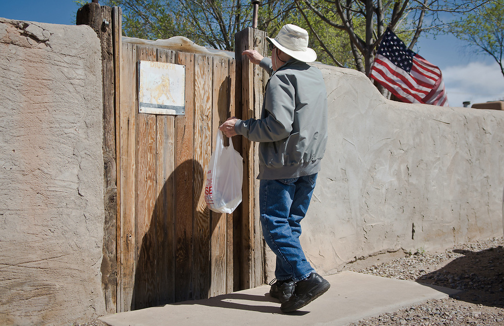 Frank Elkin, a Meals on Wheels volunteer, makes a food delivery to a home in Albuquerque, N.M., Friday, March 24, 2017. Meals on Wheels delivers about 550 meals a day. (Marla Brose/Albuquerque Journal)