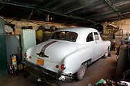 Old American car being repaired in San Antonio de Rio Blanco, Mayabeque Province, Cuba.