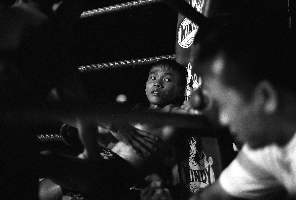 No matter what the age, Young Muay Thai kickboxers give it their all at a small make-shift arena just outside Bangkok, Thailand..March 2003.©David Dare Parker /AsiaWorks Photography
