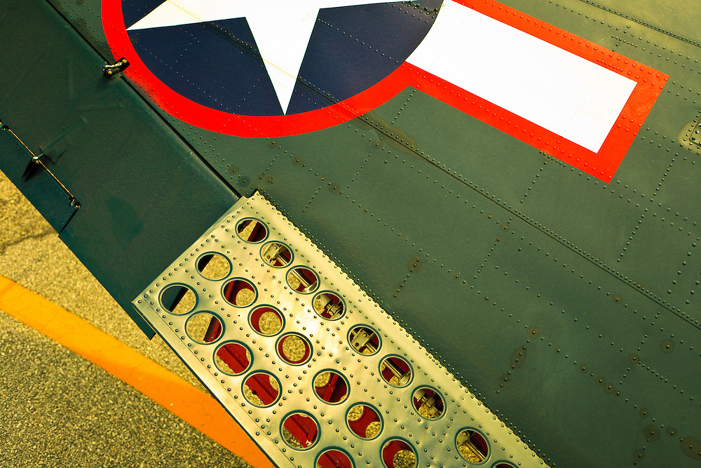 """Wing detail showing the """"speed brakes"""" on an SBD-5 Dive Bomber.  Owned by the Dixie Wing of the Commemorative Air Force.  One of three still flying in the world."""