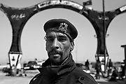 A Libyan opposition fighter poses for a portrait March 1, 2011 at an opposition checkpoint and anti-aircraft position at the entrance of the eastern Libyan city of Ajdabiya. .Slug: Libya.Credit: Scott Nelson for the New York Times