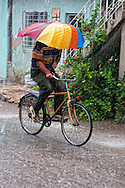 Bicycling in a storm in Holguin, Cuba.
