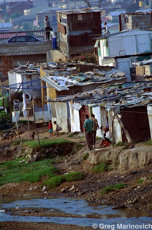 Alexandra Township, Sandton, Johannesburg, South Africa. A view of shacks built below the floodline in Alexandra township, in Johannesburg. 1991-3