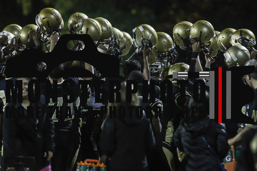 The Newark players celebrate a victory after a 51-24 regular season win Delcastle Friday, Oct. 30, 2015 at Newark High School in Newark.