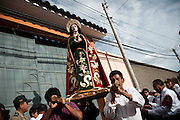 The image of St. John the Baptist is taken in procession on Tuesday during the Holy Week celebrations in Ayacucho, Peru.