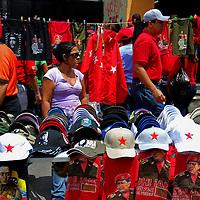 VENEZUELAN POLITICS / POLITICA EN VENEZUELA<br /> Seller of shirts and caps of political slogans / Vendedor de camisas y gorras de consignas politicas<br /> Caracas - Venezuela 2009<br /> (Copyright &copy; Aaron Sosa)