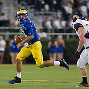 Delaware Quarterback Trent Hurley (12) scrambles towards the sidelines during a Week 1 NCAA football game against West Chester. ..#15 Delaware defeated West Chester 41-21 in their home opener at Delaware Stadium Thursday Aug. 30, 2012 in Newark Delaware...Delaware will return home Sept. 8, 2012 at 3:30pm for a showdown with interstate Rival Delaware State in the Route 1 Rivalry Bowl at Delaware Stadium.