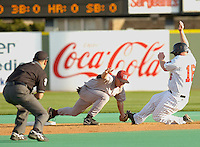 Jodi Miller Lubbock Avalanche-Journal.New Mexico's short stop Richard Stout, 14, tags out Texas Tech's Matt Smith, 16, at second base during Tuesday night's game at Dan Law Field.