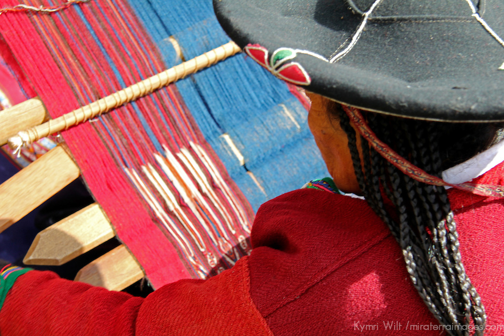 South America, Peru, Chinchero. Woman weaving on loom at the Center for Traditional Textiles in Cusco Cooperative.
