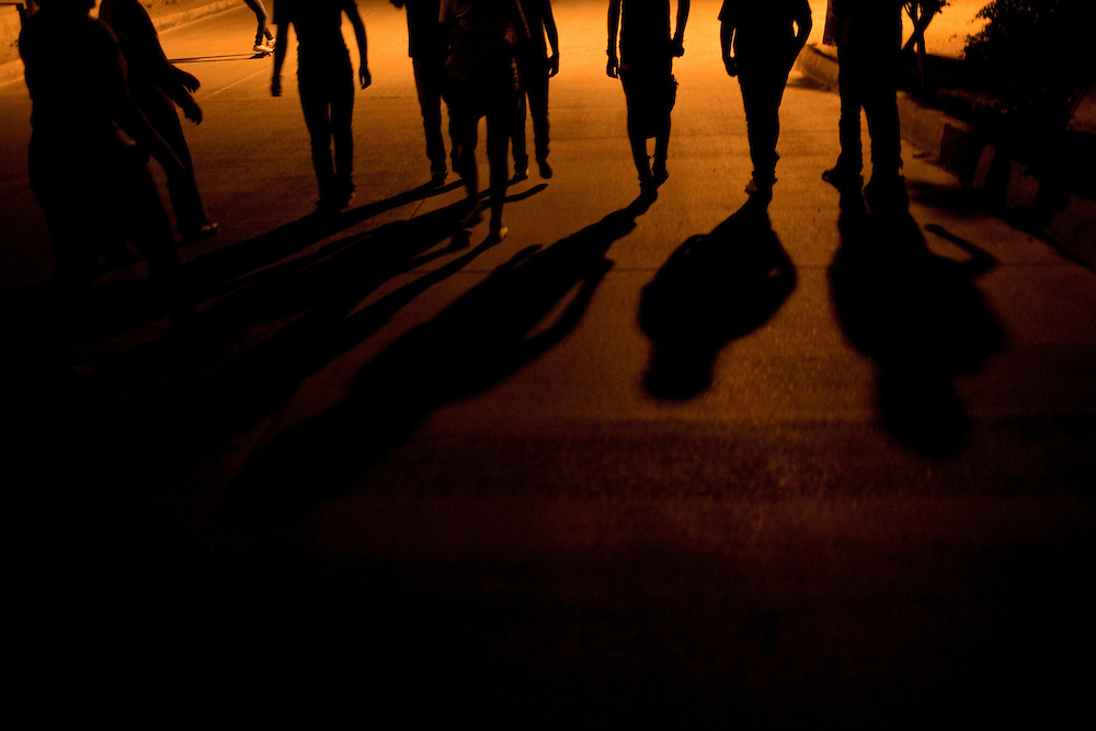 Friends walk home together in large groups after dark to stay safe in the Diaz Ordaz colonia, a gang area, in Ciudad Juarez, Chihuahua Mexico on May 7, 2010. ..