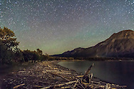 Driftwood Beach at Waterton Lakes National park, lit by starlight and glows from town and hotel lights across the lake. A single 45-second exposure with the 24mm lens at f/3.5 and Canon 5D MkII at ISO 5000.