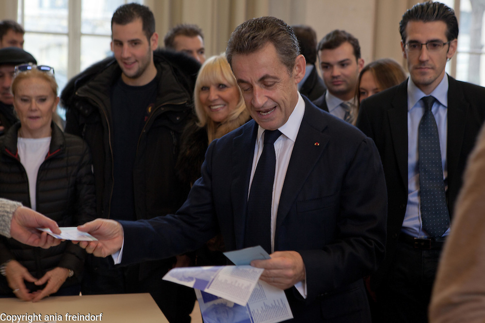 Nicolas Sarkozy  former President of France voting during regional elections in Paris, with his wife Carla Bruni Italian-French singer and former model, 13 december 2015, France