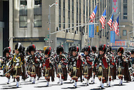 Pipers in Traditional Tartan Dress with Bagpipes on Tartan Day Parade in Manhattan.