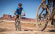 SHOT 10/15/16 2:14:25 PM - Mountain biking the White Rim Trail. The White Rim is a mountain biking trip in Canyonlands National Park just outside of Moab, Utah. The White Rim Road is a 71.2-mile-long unpaved four-wheel drive road that traverses the top of the White Rim Sandstone formation below the Island in the Sky mesa of Canyonlands National Park in southern Utah in the United States. The road was constructed in the 1950s by the Atomic Energy Commission to provide access for individual prospectors intent on mining uranium deposits for use in nuclear weapons production during the Cold War. Four-wheel drive vehicles and mountain bikes are the most common modes of transport though horseback riding and hiking are also permitted.<br /> (Photo by Marc Piscotty / &copy; 2016)