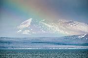 Snow covered hills, Yellowstone National Park, USA rainbow, lake