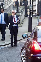 Downing Street, London, January 24th 2017. Secretary of State for Exiting the European Union David Davis leaves his Downing Street office for Parliament where he is to deliver an address following the Supreme Court's ruling that Article 50 - Brexit - cannot be triggered without an Act of Parliament. Police prevented his exit from Downing Street by car as they were awaiting the Prime Minister's departure, forcing him to walk to the Commons.