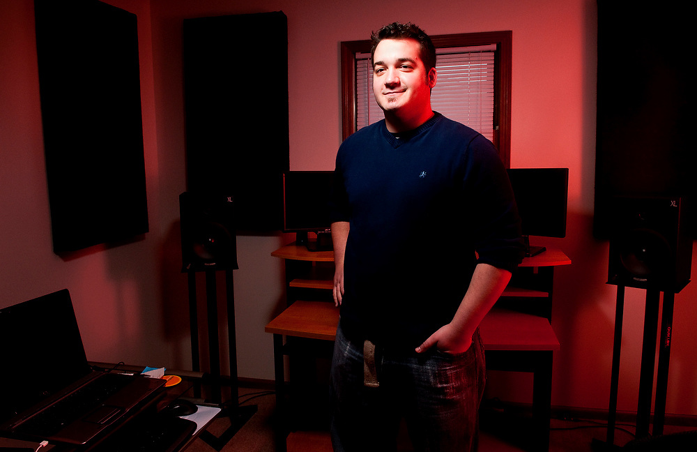Sean Beeson stands in his home studio in Bucyrus on Thursday. Beeson, a 2003 Buckeye Central graduate, works as a music composer for the video game industry.
