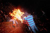 """BURNING PEOPLE ON THE WALL"".TAR BARRELS OF OTTERY ST MARY EAST DEVON..BY RUPERT RIVETT©2003..07771928201.(01273)695107"