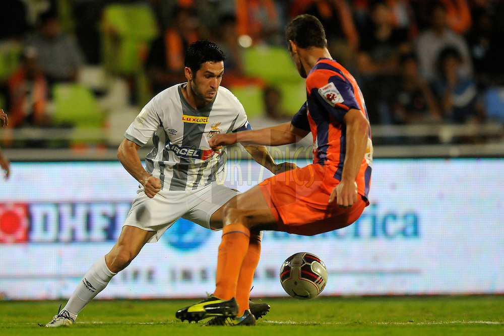 Luis Javier Garcia Sanz of Atletico de Kolkata  and Krisztian Vadocz of Pune City during match 44 of the Hero Indian Super League between FC Pune City and Atletico de Kolkata FC held at the Shree Shiv Chhatrapati Sports Complex Stadium, Pune, India on the 29th November 2014.<br /> <br /> Photo by:  Pal Pillai/ ISL/ SPORTZPICS