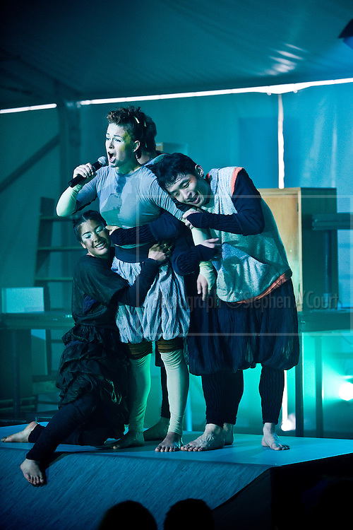 Wellington, NZ. 11 March 2013. DOWN BENEATH BELOW, Odlin Plaza on the Wellington waterfront, by Java Dance Company. Part of the Capital E National Arts Festival, 11-23 March 2013. Performers: Lauren Carr (albatross), Michael Gudgeon (penguin), Isabelle Nelson (sealion), Sam Wang (penguin). Choreographer, Sacha Copeland. Production Designer, Meg Rollandi. Java Dance Company takes us on an icy journey inspired by Our Far South, a Morgan Foundation project aimed at raising New Zealanders' awareness of the area south of Stewart Island. Photo credit: Stephen A'Court. COPYRIGHT: ©Stephen A'Court
