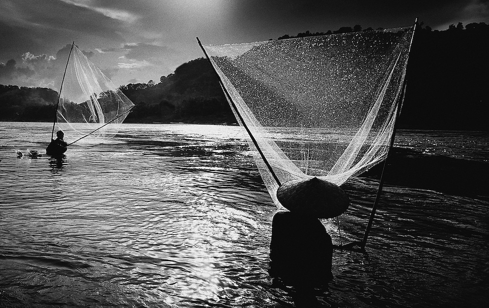 Fishing the Mekong river in Luang Prabang, Laos.