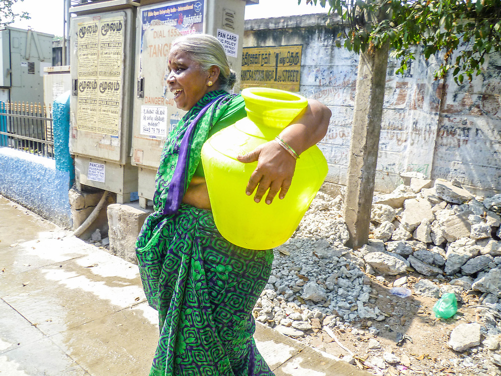 Yellow, Chennai, India by Kavya. <br /> <br /> An Indian old lady carrying water back to her household in an urban slum in Chennai, India. <br /> <br /> Kavya is 11 years old and she has already found her interest in Science subjects and she would like to be an engineer in the future.