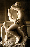 """Image of Rodin's """"The Kiss"""" sculpture at the Musee Rodin in Paris, France"""