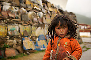 This dirty tibetan girl probably hasn't seen a bath in months.  Cleanliness isn't aa big concern to Tibetans since the cold climate and high altitudes help keep stinky bacteria at bay.  Litang, Tibet (China)