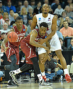 March 20, 2014: New Mexico State Aggies guard Ian Baker (4) and San Diego State Aztecs forward Josh Davis (22) battle for a loose ball during a second round game of the NCAA Division I Men's Basketball Championship between the 4-seed San Diego State Aztecs and the 13-seed New Mexico State Aggies at Spokane Arena in Spokane, Wash. San Diego State defeated New Mexico State 73-69 in overtime.