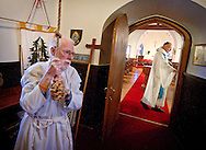 NORTH LAKE, WI &mdash; JANUARY 18, 2015:  Reverend David Couper prepares for mass as junior warden Peter Buerosse rings the bells at the St. Peter's Episcopal Church, Sunday, January 18, 2015. <br />